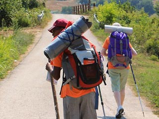 m pilgrims walk together on path to san Francesco of Assisi