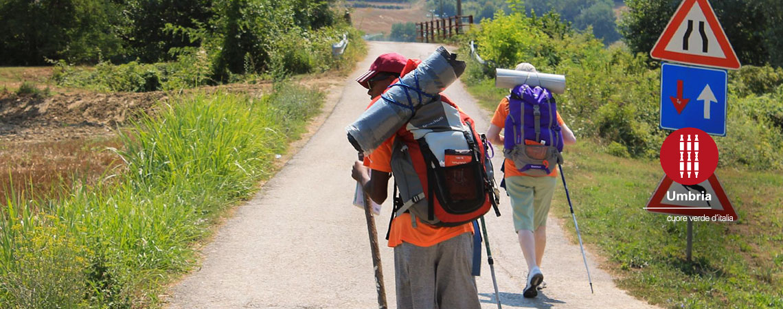 pilgrims walk together on path to san Francesco of Assisi